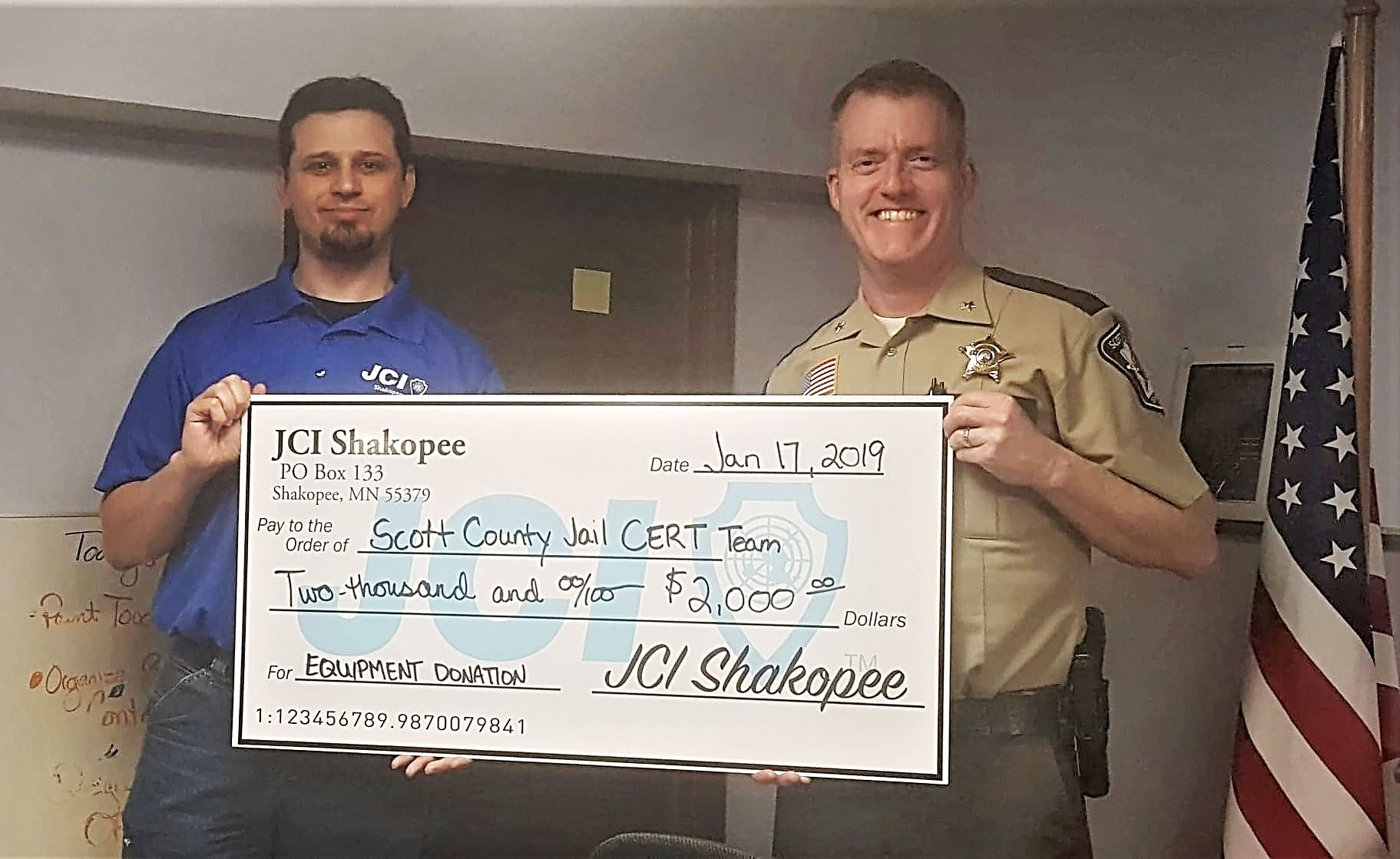 Shakopee Jaycees President Drew Kothenbeutel presents Sheriff Hennen with $2,000 donation